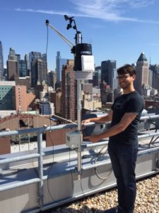 Intern Joe Silver sets up a solar radiation sensor for a research project at John Jay College.