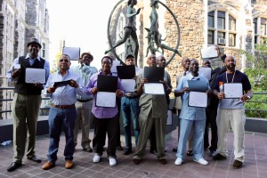 Graduates of the Covington Real Estate cohort proudly display their Building Operator Training certificates.
